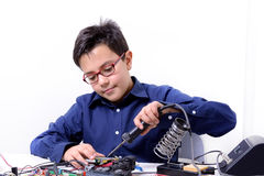Young student performs experiments Stock Photography