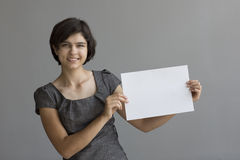 Young student points to a sign Royalty Free Stock Photography