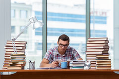 The young student preparing for college exams Stock Photo