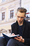 Young student preparing for the exam in old center of europe cit Stock Photography