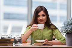 The young student preparing for exams drinking tea Royalty Free Stock Images