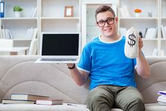 The young student preparing for exams studying at home on a sofa Royalty Free Stock Image