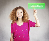 Young student pressing learn more botton Royalty Free Stock Photos