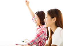 Young student  raised hands in class Royalty Free Stock Photos
