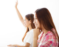 Young student  raised hands in class Stock Photos