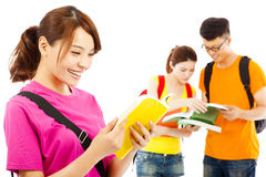 Young student read a  book  with classmates. Over white Stock Images