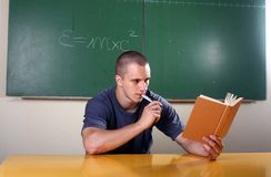 Young student reading Stock Images