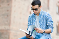 Young student reading a book Stock Photo