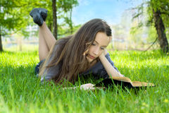 Young student reading book in park Stock Photography