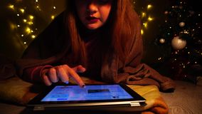 Young student reading merry hristmas poem by tablet. stock video