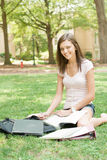 A young student ready for class. A pretty young college or high school age girl with study materials stock image