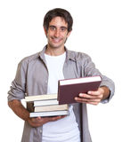 Young student recommending a book Royalty Free Stock Image