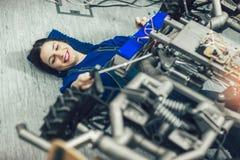 Young student of robotics preparing car robot for testing Royalty Free Stock Photos