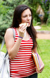 The young student with a sandwich Stock Photo