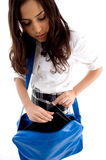 Young student searching in her school bag. On an isolated background stock image