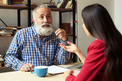 Young student and senior bearded professor Royalty Free Stock Photography
