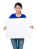 Young student showing the blank sign of white board Royalty Free Stock Images