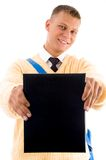 Young student showing his book Royalty Free Stock Photography