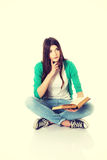 Young student sitting with book, reading. Stock Image