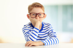 Young student sitting at desk Stock Photography