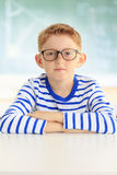 Young student sitting at desk Royalty Free Stock Image