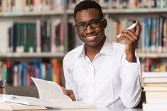 Young Student Sitting At The Library Royalty Free Stock Photos
