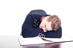 Young student sleeping on his paperwork Royalty Free Stock Photo