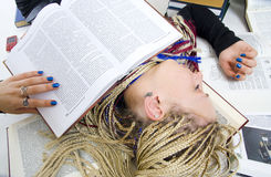 The young student sleeps on books Stock Photos