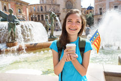 Young student smiling happy and drinking coffee in Valencia, Spain. stock images