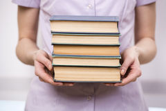 The young student with stack of books Stock Image