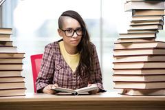 The young student with stack of books Stock Images
