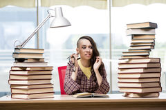 The young student with stack of books Royalty Free Stock Photos