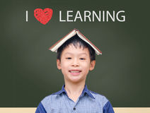 Young student standing with book on head Royalty Free Stock Photography