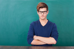 Young Student Standing In Front Of Chalkboard Royalty Free Stock Photos