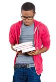 Young student stressed holding books Stock Photo