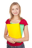 Young student in a studio with textbooks Royalty Free Stock Image