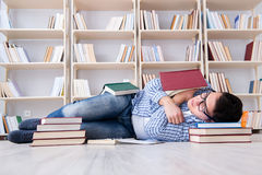 The young student studying with books. Young student studying with books Royalty Free Stock Photos