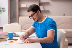 Young male student studying at home