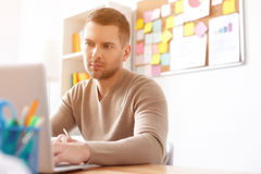 Young student studying at home Stock Photography