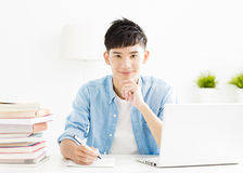 Young student studying in living room Stock Photos