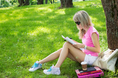 Young student studying in park Stock Photo