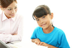 Young student studying with teacher Stock Images