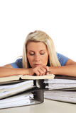 Young student taking nap on her documents royalty free stock image