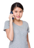 Young student talk to cellphone Stock Images