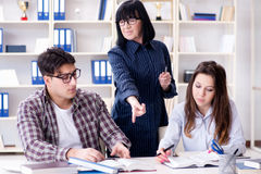 The young student and teacher during tutoring lesson Royalty Free Stock Image