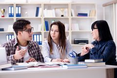 The young student and teacher during tutoring lesson. Young student and teacher during tutoring lesson Stock Photography
