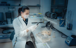 Young student or tech with laboratory mouse Stock Photo
