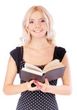Young student with textbook. Young beautiful girl-student with textbook, it is isolated on white background Stock Photo