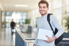 Young student with textbooks smiles Royalty Free Stock Photos