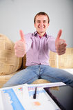 Young student thumbs up. Young student is happy about his study Stock Images